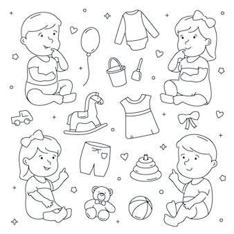 Bébé fille et garçon avec des jouets et des vêtements doodle ensemble.