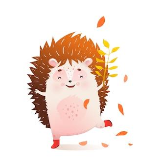 Bébé hérisson danse avec des feuilles d'automne en automne