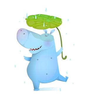 Bébé hippopotame danse avec feuille sous la pluie