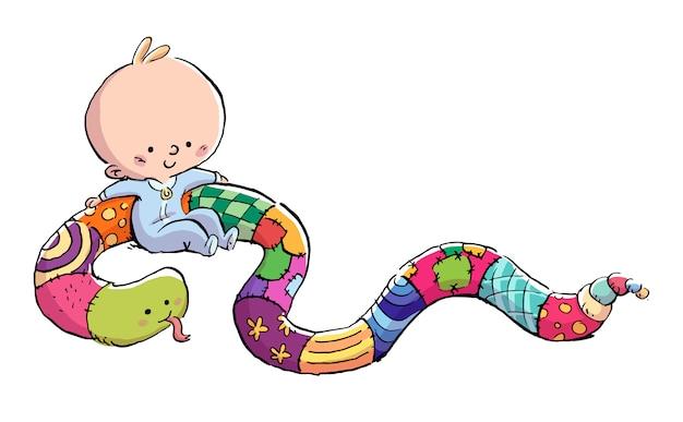 Bébé jouant avec un animal en peluche