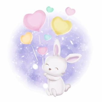 Bébé lapin avec de jolis ballons