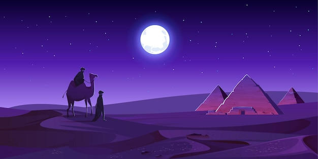 Les bédouins à pied aux pyramides d'égypte à dos de chameau dans le désert de nuit
