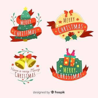 Bel ensemble d'étiquettes de Noël avec un design plat