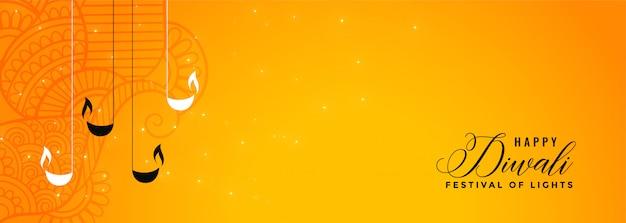 Belle bannière joyeuse jaune diwali avec diya