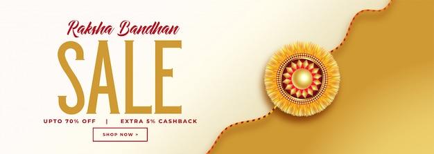 Belle bannière de vente de raksha bandhan avec rakhi d'or