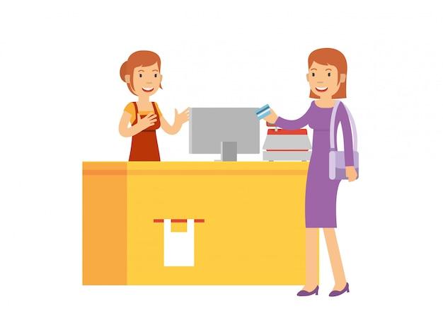 La belle caissière sert le client au supermarché