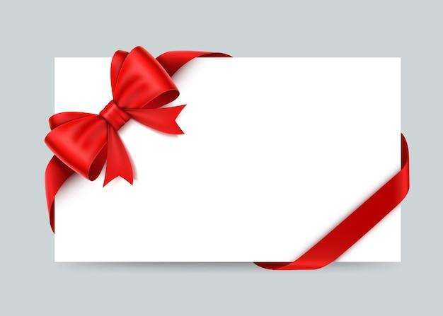 Belle carte avec des arcs et des rubans de cadeau rouge.