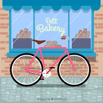 Belle composition avec vélo et boulangerie
