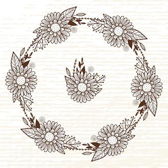Une belle couronne de fleurs et de feuilles sauvages