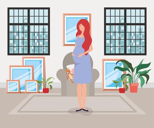Belle femme enceinte dans la scène du salon