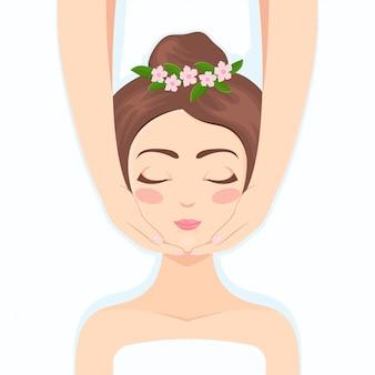 Belle femme faisant un massage facial
