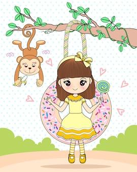 Belle fille assise sur une balançoire donut avec un ami singe