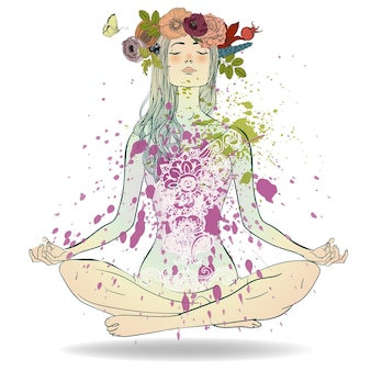 Belle fille avec une couronne de fleurs assise dans une pose de lotus