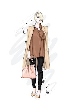 Belle fille dans un manteau élégant