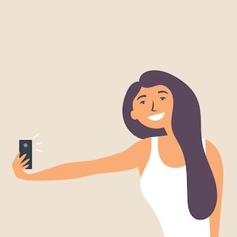 Belle fille prend un selfie