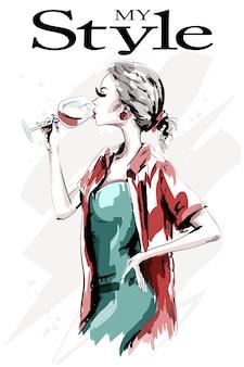 Belle fille avec un verre de vin