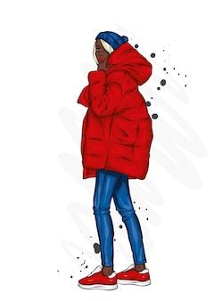 Belle fille en vêtements d'hiver élégants