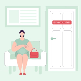Une belle jeune femme enceinte est assise à l'hôpital sur une chaise