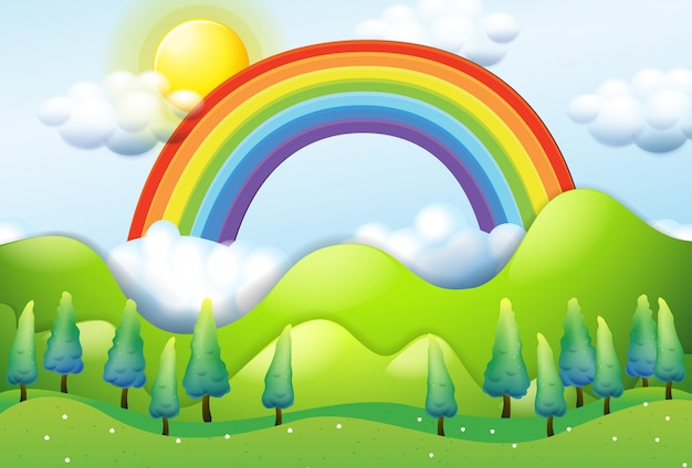 Belle montagne verte et arc-en-ciel