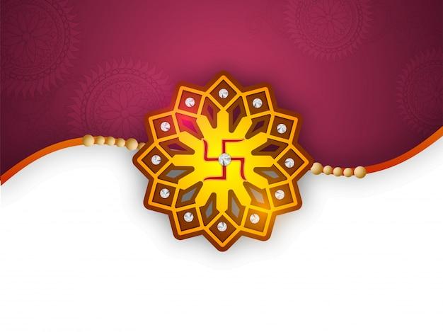 Belle rakhi décorative avec un symbole swastika pour le festival indien, fête de raksha bandhan.