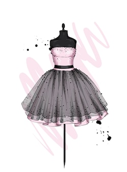 Une belle robe avec une jupe luxuriante. vêtements sur un mannequin.