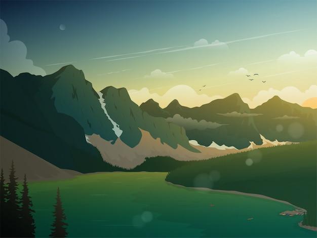 La belle vue sur le coucher du soleil dans les montagnes et le lac