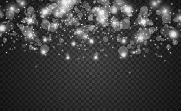 De belles étincelles brillent d'une lumière spéciale. scintille sur un fond transparent.
