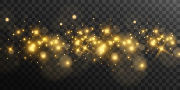 Belles étincelles dorées lumineuses sur fond transparent.