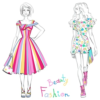 Belles filles à la mode dans des robes colorées avec inscription beauty and fashion