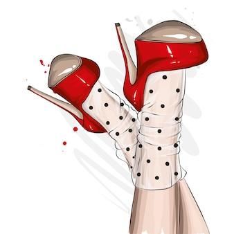 Belles jambes féminines en chaussures à talons hauts.