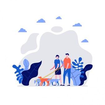 Bénévoles au travail. heureux jeune couple, homme et femme marchant avec chien ensemble. concept de prendre soin des animaux et de bénévolat.