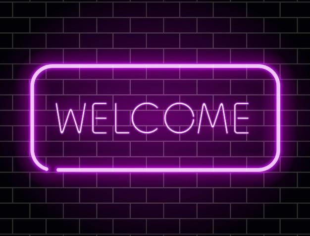 Bienvenue au néon. cadre néon de couleur sur le mur de briques. enseigne de nuit rougeoyante réaliste.