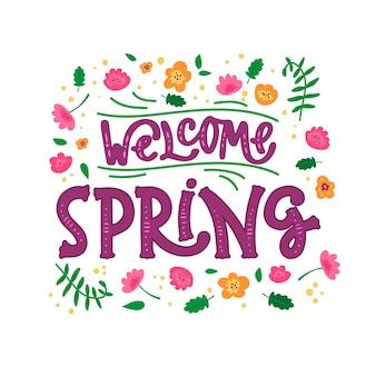 Bienvenue lettrage de printemps avec des fleurs
