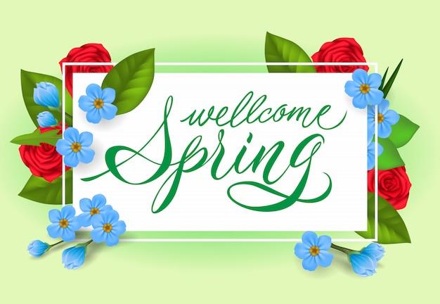 Bienvenue lettrage de printemps. inscription créative avec des fleurs roses et bleues.