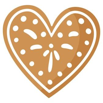 Biscuit de pain d'épice coeur festif de noël recouvert de glaçage blanc.