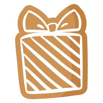 Biscuit de pain d'épice présent festif de noël recouvert de glaçage blanc.