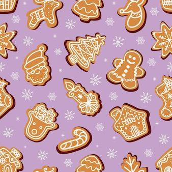 Biscuits de pain d'épice de noël parmi des flocons de neige