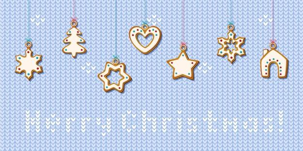 Biscuits de pain d'épice de noël suspendus sur fond tricoté. biscuits faits maison en forme de maison et arbre de noël, étoile et flocon de neige et coeur pour carte et bannière web festive. illustration vectorielle
