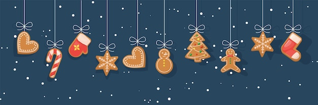 Biscuits de pain d'épice suspendus sur fond neigeux d'hiver. bannière de noël avec des biscuits de pain d'épice suspendus. nourriture de vacances sucrée. snack au gingembre dessert fait maison traditionnel. gâteau de glaçage aux biscuits aux biscuits.
