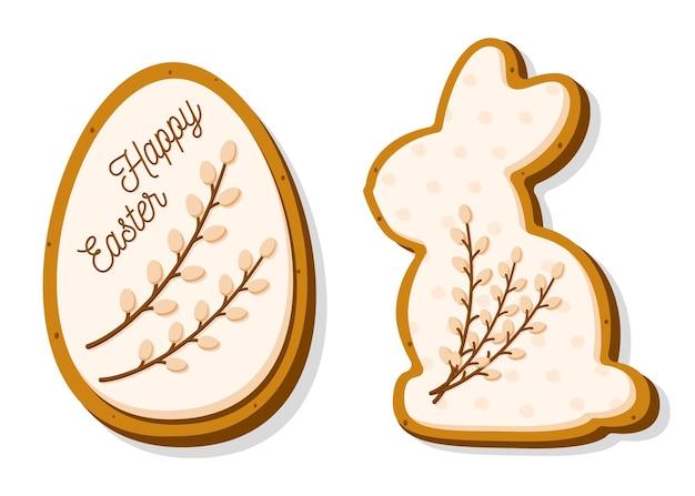 Biscuits de pâques sous forme d'oeuf et de lapin. biscuits de pain d'épice avec glaçage pastel et saule