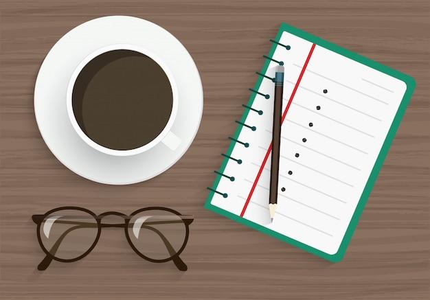 Bloc-notes, crayon, verres et café