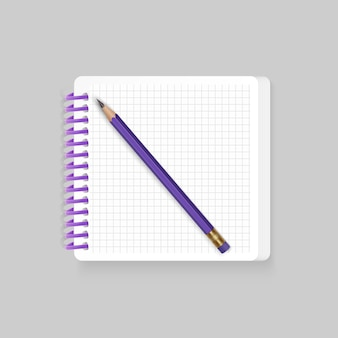 Bloc-notes à spirale vierge avec un crayon réaliste