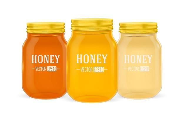 Bocal en verre réaliste de miel sertie de couvercle doré gros plan isolé sur fond blanc modèle de conception