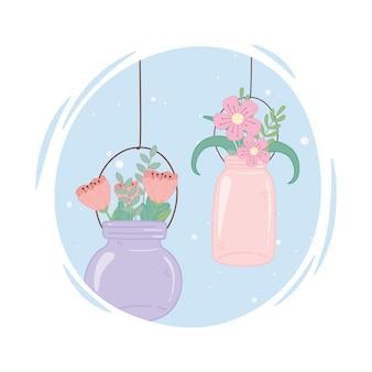 Bocaux mason en verre avec des fleurs suspendues