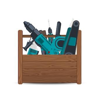 Boîte en bois avec des outils de construction électriques isolés on white