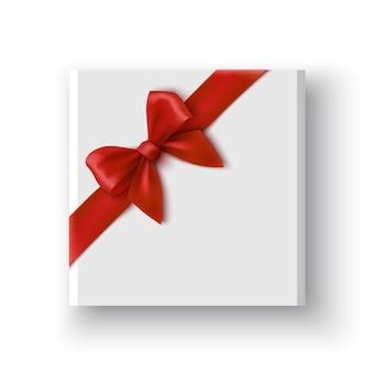 Boîte cadeau blanche avec noeud rouge paquet avec illustration de ruban