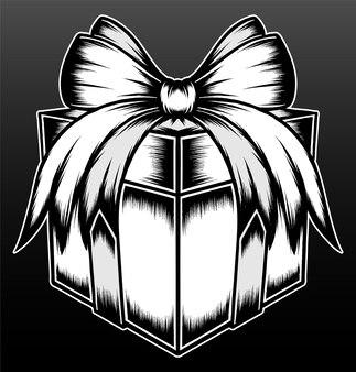 Boîte cadeau blanche noire isolée sur fond noir
