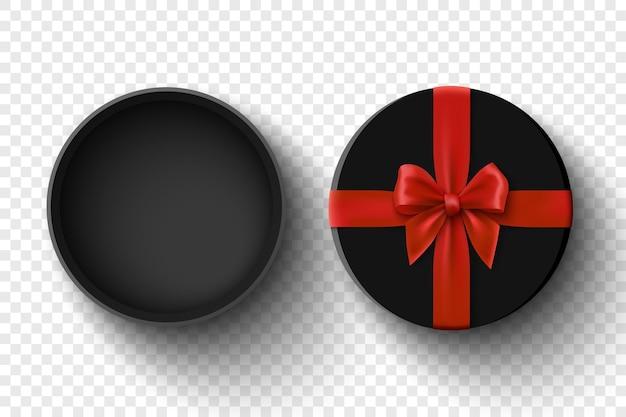 Boîte cadeau ouverte ronde noire avec noeud rouge sur fond transparent paquet avec ruban