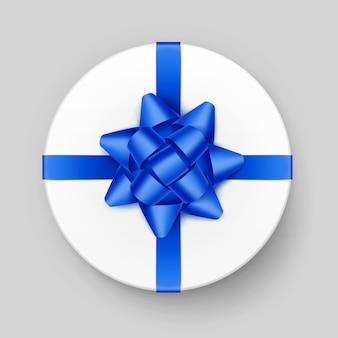 Boîte-cadeau ronde blanche de vecteur avec noeud bleu brillant et ruban