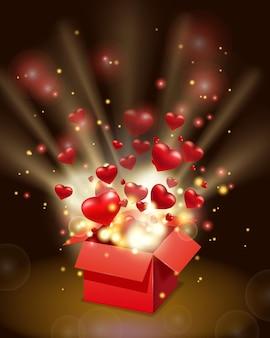 Boîte cadeau rouge ouverte présente avec des coeurs volants et des rayons lumineux, explosion éclatée